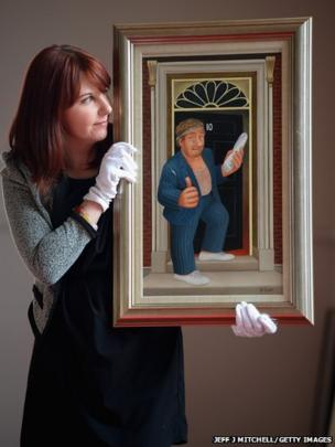 Kim Aitchison holds a painting by artist Beryl Cook at Lyon & Turnbull auctioneers in Edinburgh, Scotland