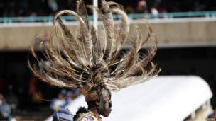 A traditional dancer leaves after entertaining guests before the official swearing-in ceremony of Kenya's President elect Uhuru Kenyatta at Kasarani Stadium in the capital Nairobi, 9 April 2013