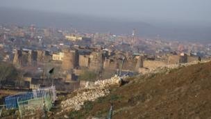 A modern cemetery overlooking the fortress of Ghazni