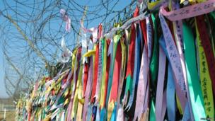 Ribbons with peace messages and prayers. Photo: Katie Sharp