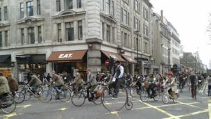 Men and women dressed in tweed on bikes in London, England. Photo: Sherie Ryder