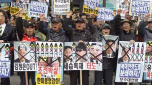 South Korean conservative protesters chant slogans during a rally demonstrating against North Korea on April 15, 2013 in Seoul, South Korea
