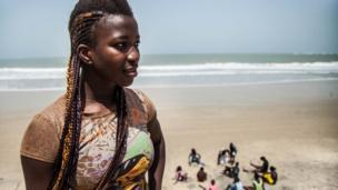 Sirefina Diediou on a beach
