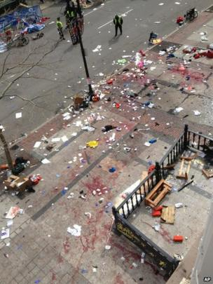Blood on the streets at the scene of one of the explosions at the Boston marathon, 15 April 2013