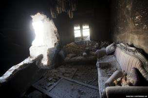 An apartment destroyed by tank shelling is seen in a building in the Karm al-Jabel neighbourhood after several days of intense clashes between rebel fighters and the Syrian army in Aleppo, Syria, 28 October 2012