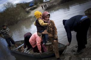 Syrian refugees cross from Syria to Turkey via the Orontes River, near the village of Hacipasa, Turkey, 8 December 2012