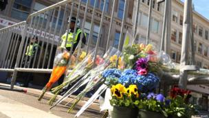 Flowers are left at a security gate near the scene of the attack at the Boston Marathon on 16 April 2013 in Boston, Massachusetts.