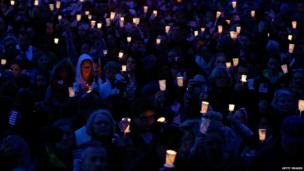People gather with candles during a vigil for eight-year-old Martin Richard, from Dorchester in Boston, who was killed by an explosion near the finish line of the Boston Marathon on April 16, 2013 at Garvey Park in Boston, Massachusetts.