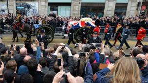 The coffin of British former prime minister Margaret Thatcher is carried on a gun carriage