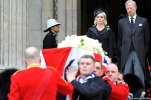 Mark Thatcher and his wife Sarah watch as the coffin of his mother is carried by military personnel outside St Paul's Cathedral after the funeral service