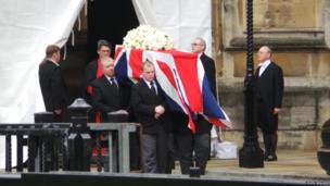 Coffin leaves the Palace of Westminster. Photo: John Walker