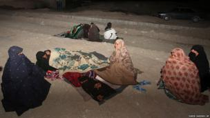 Iranians stay outside their homes at the Gosht district after an earthquake hit south eastern Iran.