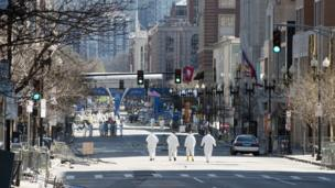 Agents continue to search for evidence along the Boston Marathon route on Thursday morning.