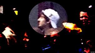 Suspect in white cap
