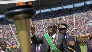 Zimbabwe's President Robert Mugabe lights the independence flame in Harare - Thursday 18 April 2013