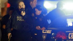 Police officers work a crime scene in Watertown