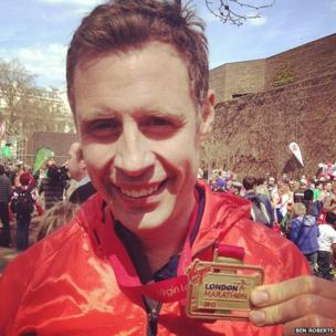 Runner shows off his medal. Photo Ben Roberts