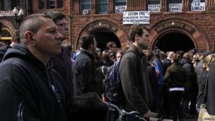 People observe a public silence on Boylston Street, Boston, 22 April