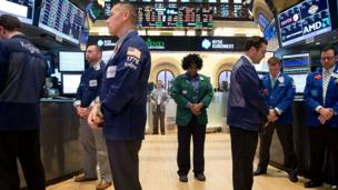 Traders at the New York Stock Exchange observe a silence, 22 April