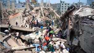 Bangladeshi civilian volunteers assist in rescue operations after an eight-storey building collapsed in Savar, on the outskirts of Dhaka, on April 24, 2013.