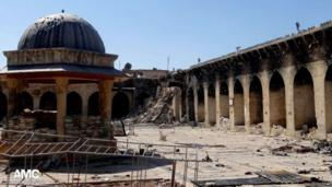 Image provided by Aleppo Media Centre AMC shows the damaged Umayyad Mosque without the minaret, background right corner, which was destroyed by the shelling, in the northern city of Aleppo, Syria, Wednesday 24 April 2013