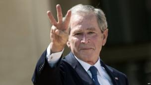 "Former President George W Bush flashes a ""W"" sign at the opening of the George W Bush Library in Dallas, Texas (25 April 2013)"