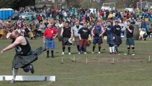 Man throws the shotput at a Highland Games