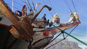 A Russian sailor aboard the Sedov with Table Mountain in the background, Cape Town, South Africa - Monday 22 April 2013