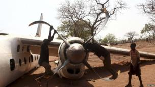 Children playing on an old aeroplane's propellers, Yida refugee camp, Unity state, South Sudan - Friday 19 April 2013