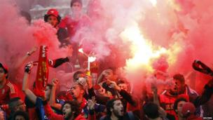Al Ahli fans with red flares - Sunday 21 April 2013