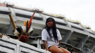 A Brazilian indigenous community protest inside the former Indian Museum, with the Maracana stadium seen in the background, in Rio de Janeiro, January 12, 2013.