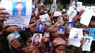 Relatives with pictures of missing loved ones. 27 April 2013