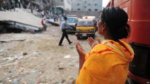 Relative prays near the scene. 27 April 2013