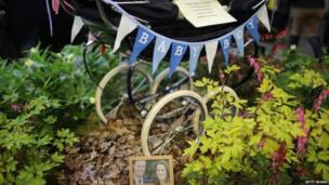 A floral display based around a baby's pram and a photograph of parents to be Catherine, Duchess of Cambridge, and Prince William, Duke of Cambridge