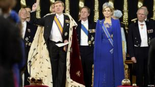 Dutch King Willem-Alexander takes the oath beside his wife, Queen Maxima, at the Nieuwe Kerk church in Amsterdam on 30 April 2013