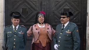 A woman dressed in a costume poses for a photo in Madrid during the Dos de Mayo parade on 2 May 2013
