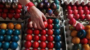 A vendor arranges hand-decorated Easter eggs at a market in Belgrade, Serbia, on 2 May 2013