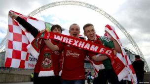 Wrexham fans make their way to the stadium prior to the Blue Square Bet Premier Conference Play-off Final match between Wrexham and Newport County at Wembley Stadium