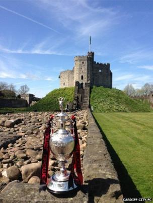 Cardiff City FC tweeted this photo of the Championship Cup proudly displayed outside Cardiff Castle before the start of the open-top bus parade