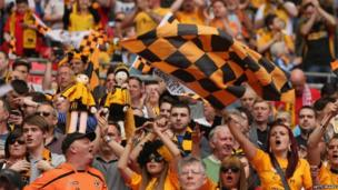A sea of yellow as Newport fans cheer on their side during the first half.