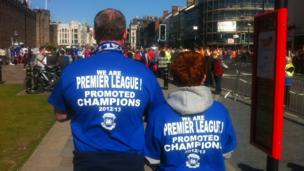 They've got the shirts - David Sherwood and son David Mico-Sherwood on their way to the champions' parade.