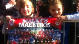 Eight-year-old Hana with her friend Rhiannon, nine, from Abergavenny were in place early to get a view of their footballing heroes.