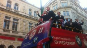 The buses made their way slowly down St Mary Street and the players waved to the fans.