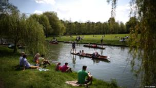 People enjoy the sunshine and punt on the River Cam on May 6, 2013 in Cambridge, England