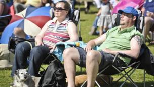 people relax in the Bank Holiday sun