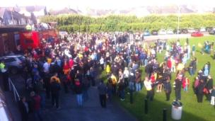 Newport County fans gather at Rodney Parade to greet the bus