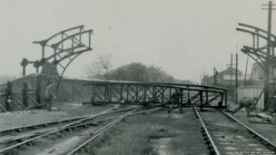 Men constructing a bridge
