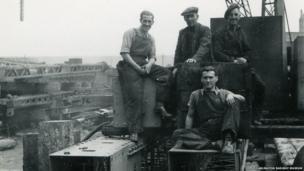 Men near a bridge