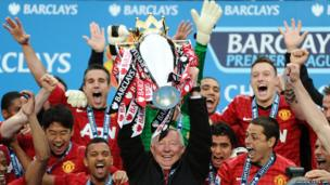 Manchester United's manager Alex Ferguson lifts the Premier League trophy