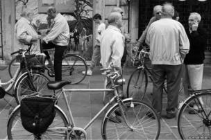 Cyclists talking on the pavement